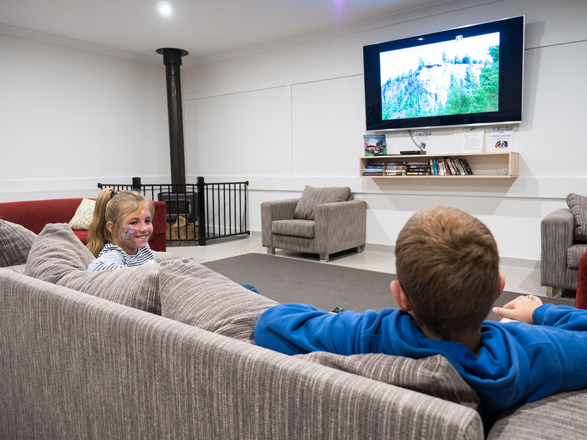 Relax in the cosy Recreation Room with Giant Flat Screen TV.